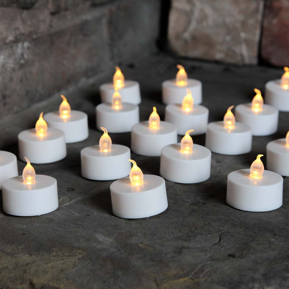 Click to view product details and reviews for 100 Battery Operated Flickering Led Tea Light Candles White Base.