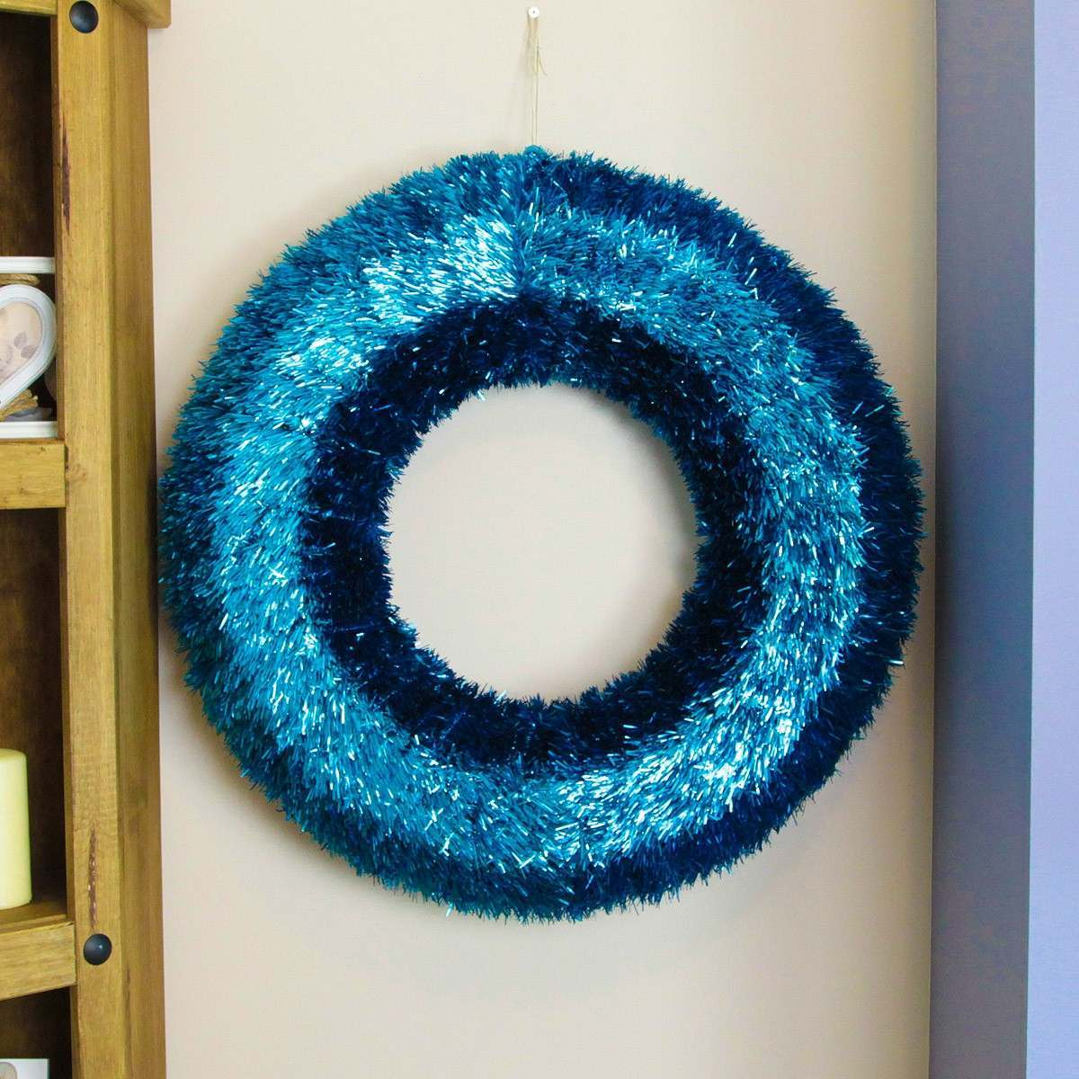 Click to view product details and reviews for 60cm Indoor Turquoise Tinsel Wreath.