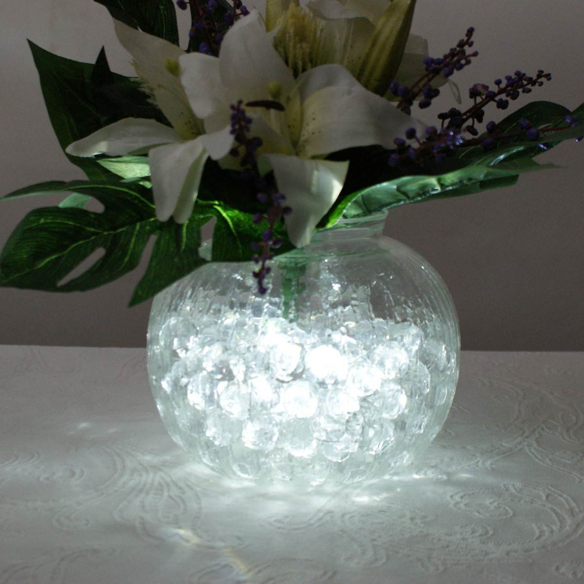 Click to view product details and reviews for Battery Powered Submersible Led Tea Light White 4 Pack.