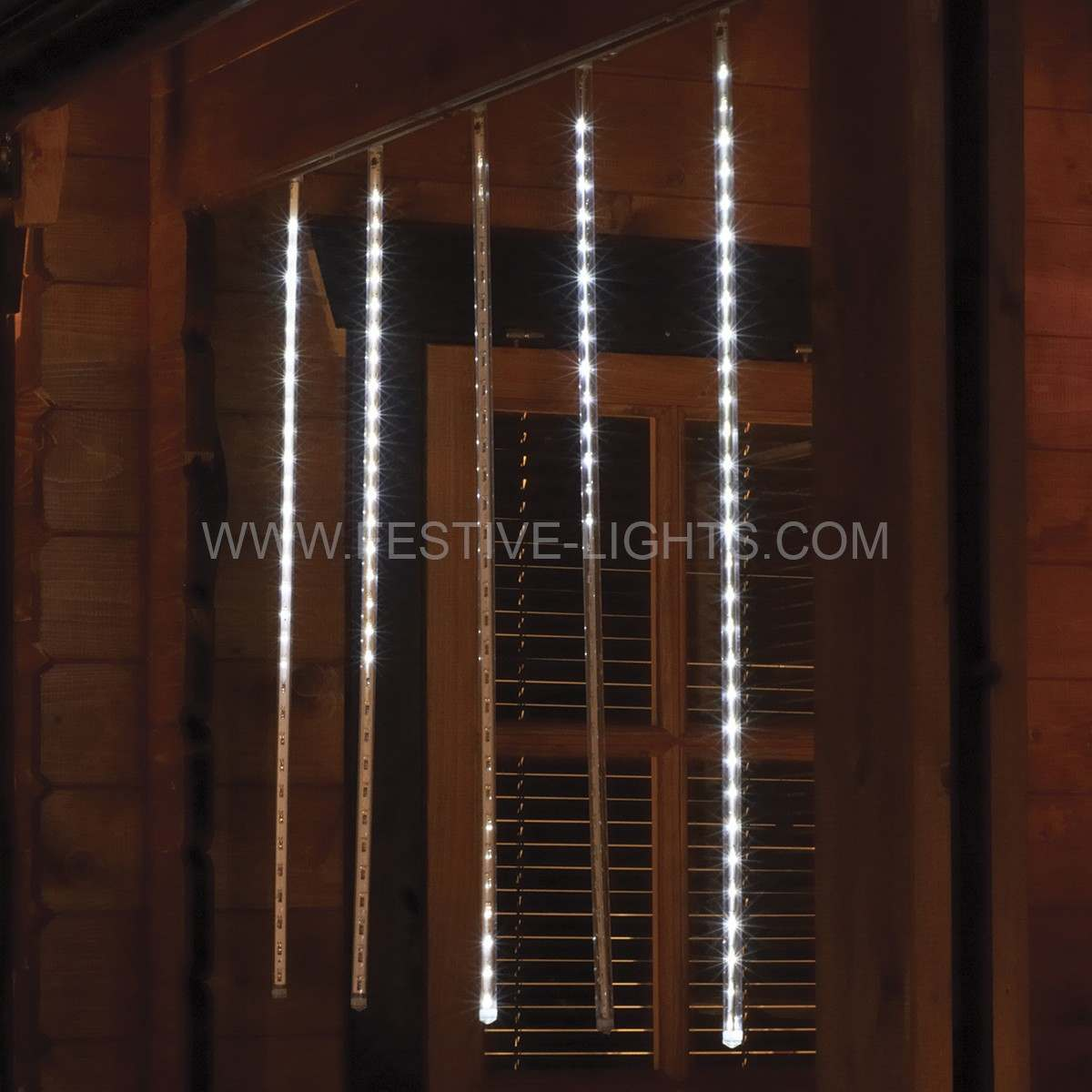 Click to view product details and reviews for Snowing Shower Icicle Lights 150 White Leds 5 X 50cm Drops.