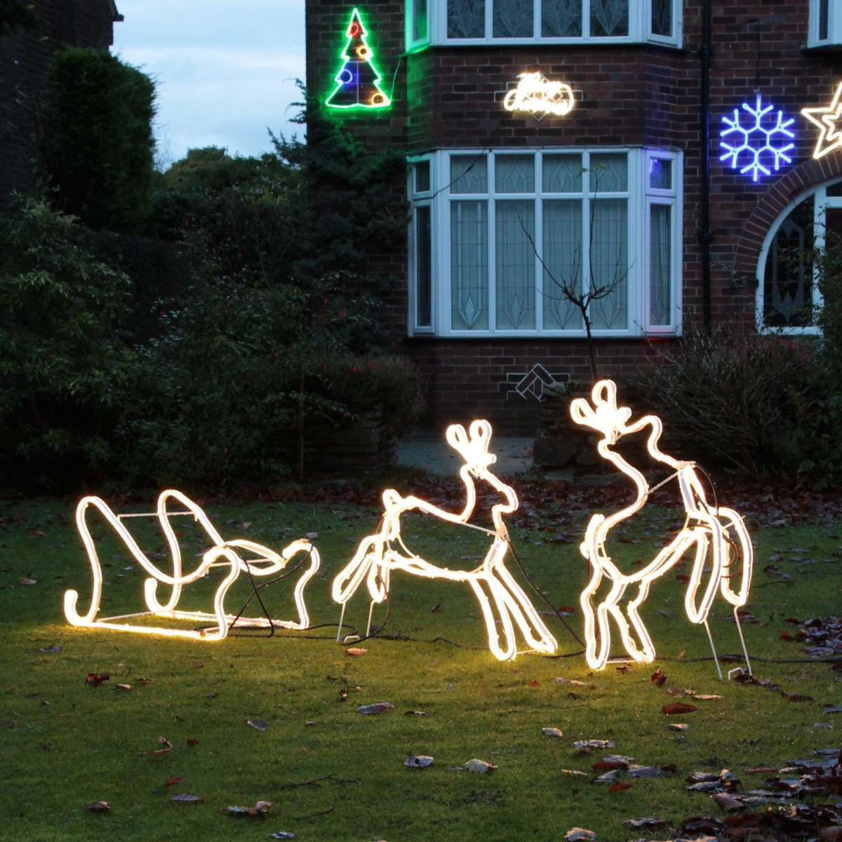 Click to view product details and reviews for 2 Warm White Reindeer Pulling Sledge 12v 798 Leds.