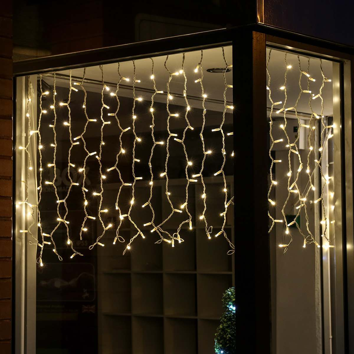 Click to view product details and reviews for 2m X 1m Outdoor Christmas Curtain Lights Connectable 200 Warm White Leds White Cable.