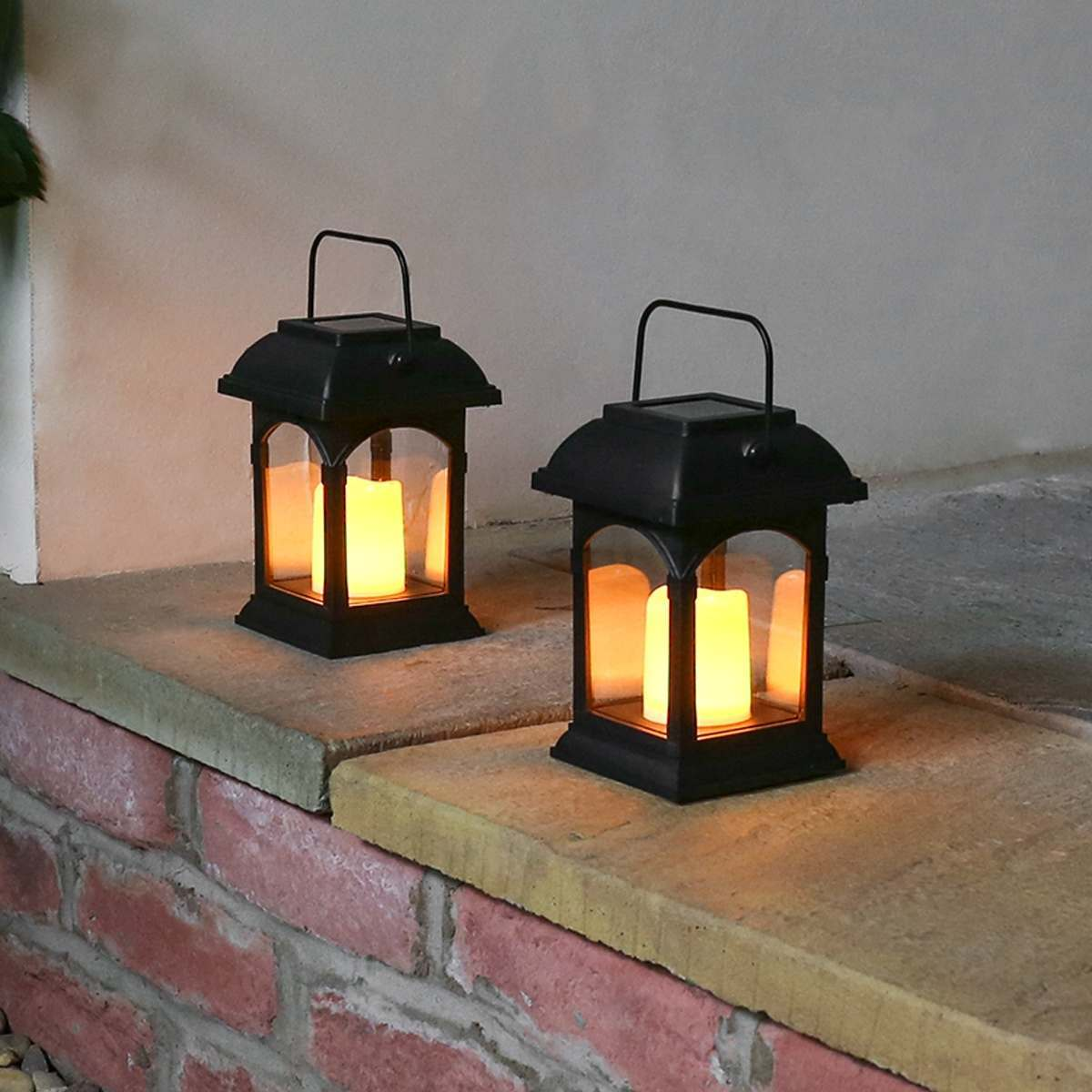 solar powered flickering led candle lantern 2 pack. Black Bedroom Furniture Sets. Home Design Ideas