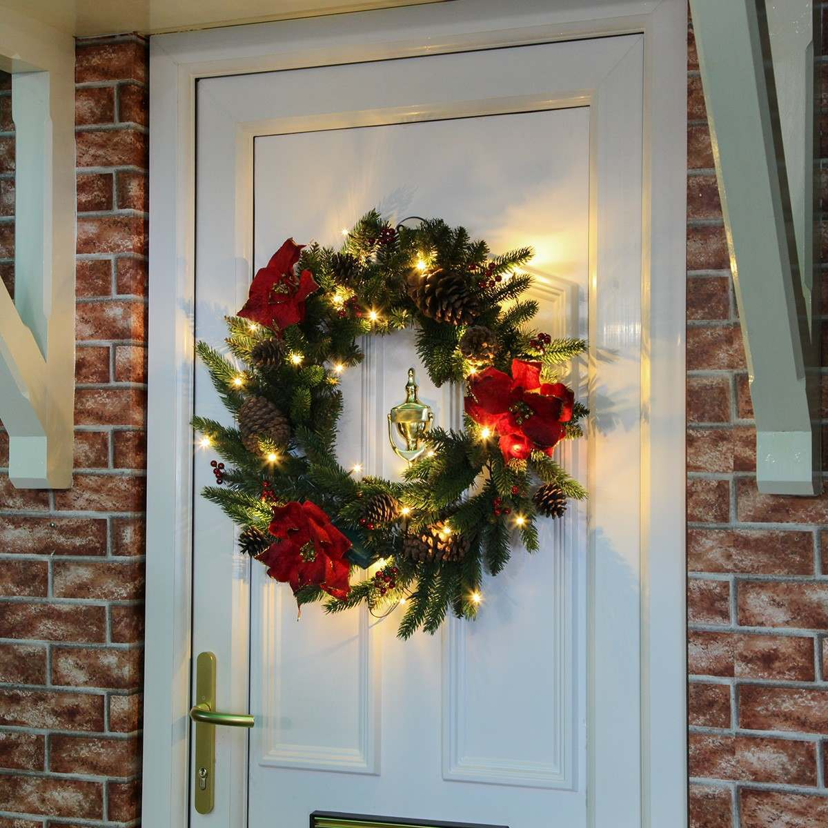 60cm Outdoor Green Battery Pre Lit Wreath With Red Poinsettias